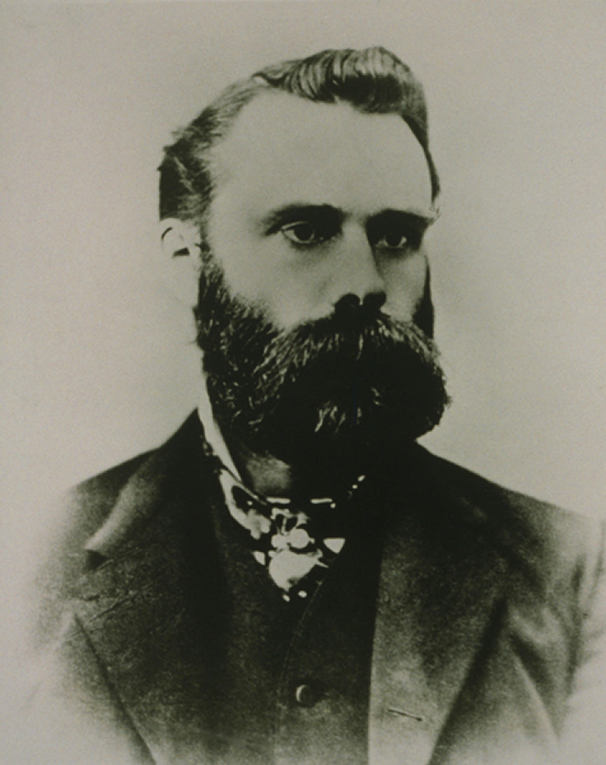 Charles H. Dow (1851-1902), a founder of Dow Jones & Co. who invented the famous Dow Jones Industrial Average in 1896. While also named after his partner, Edward Jones, Dow was the index's sole creator. Ca. 1900